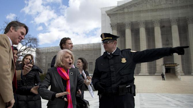 Plaintiff Edith Windsor, of New York, is helped by security in front of the Supreme Court in Washington, Wednesday, March 27, 2013, after the court heard arguments on her Defense of Marriage Act (DOMA)  case. The U.S. Supreme Court, in the second day of gay marriage cases, turned Wednesday to a constitutional challenge to the federal law that prevents legally married gay Americans from collecting federal benefits generally available to straight married couples.  (AP Photo/Carolyn Kaster)
