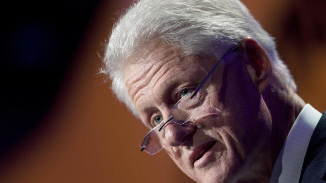 Former U.S. President Bill Clinton speaks as he opens the Clinton Global Initiative, Sunday, Sept. 23, 2012, in New York. Participants, consisting of more than 50 current or former heads of state, will attend three days of sessions aimed at solving pressing world problems. (AP Photo/Mark Lennihan)