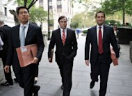 Assistant US Attorneys Edward Kim (L), Sean Buckley (C) and John Cronan (R) leave Federal Court in New York after terror suspect radical Islamist preacher Abu Hamza al-Masri appeared before US Judge Frank Maas