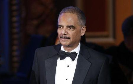 Eric Holder arrives at the 46th NAACP Image Awards in Pasadena