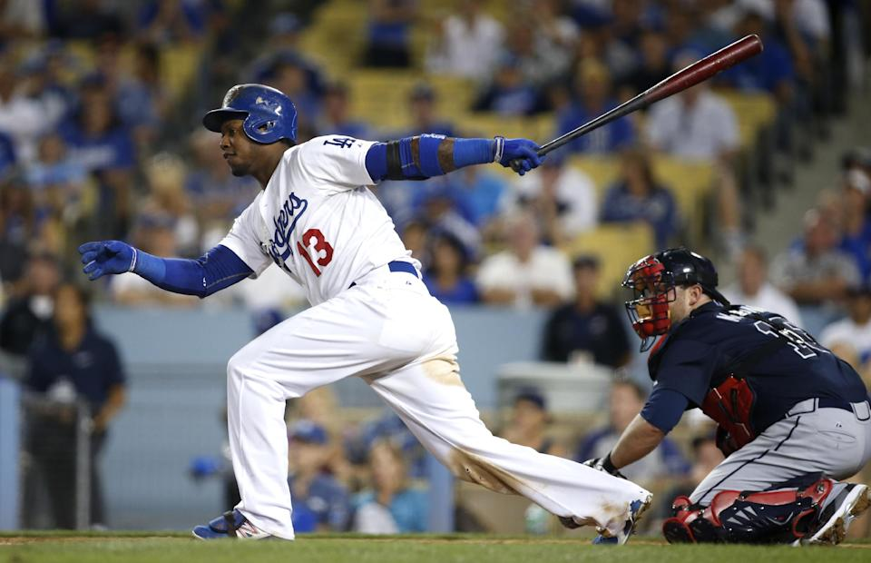 Los Angeles Dodgers' Hanley Ramirez hits an RBI single against the Atlanta Braves in the eighth inning of Game 3 of the National League division baseball series, Sunday, Oct. 6, 2013, in Los Angeles. (AP Photo/Danny Moloshok)