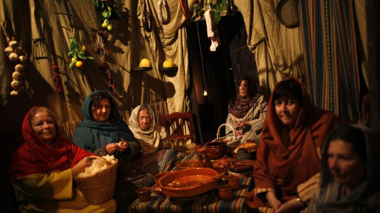 Women take part in a re-enactment of the nativity scene, in Arcos de la Frontera