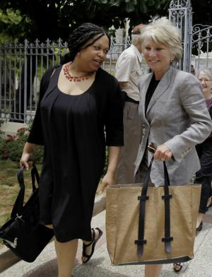 Former Democratic Rep. Jane Harman, right, and attorney Ahadi Bugg-Levine arrive at the Cuban National Center for Sex Education in Havana, Cuba, Monday, June 6, 2011. A group of U.S. women leaders met with Cuba's President Raul Castro's daughter's, Mariela Castro, for an exchange on topics including gender, reproductive health and gay rights. The trip was organized by the Center for Democracy in the Americas, which studies U.S. policy toward countries in the region. (AP Photo/Javier Galeano)