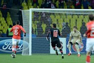 Spartak's player Rafael Carioca (L) scores during the Champions League Group G football match between Spartak and Benfica in Moscow. Spartak won 2-1