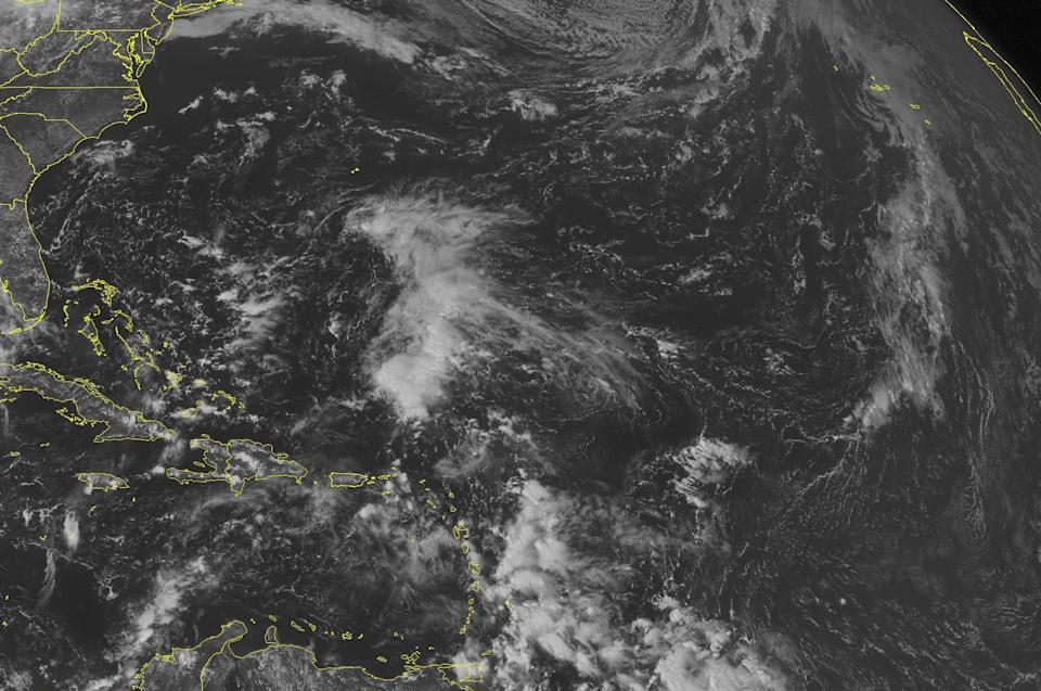 This NOAA satellite image taken Saturday, October 5, 2013 at 1:45 PM EDT shows an area of cloudiness well east of the Bahamas. More clouds associated with a tropical wave are heading towards the Lesser Antilles. The remainder of the Caribbean has widely scattered clouds. (AP Photo/Weather Underground)