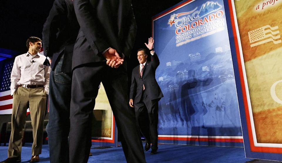 Introduced by his sons, Republican presidential candidate, former Massachusetts Gov. Mitt Romney makes a surprise appearance at a Colorado Conservative Political Action Committee (CPAC) meeting in Denver, Thursday, Oct. 4, 2012. At left is son Matt Romney. (AP Photo/Charles Dharapak)