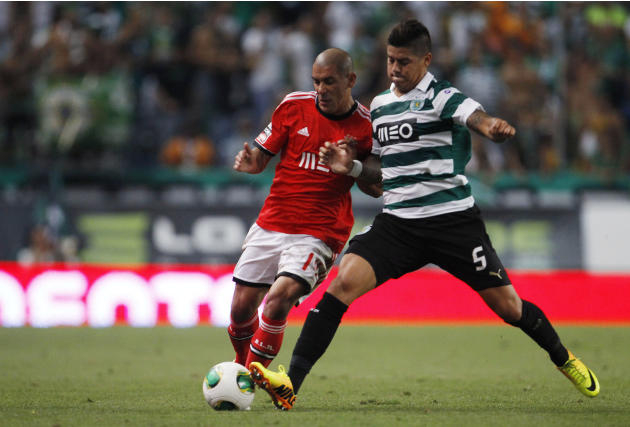Sporting's Rojo fights for the ball with Benfica's Pereira during their Portuguese Premier League soccer match in Lisbon