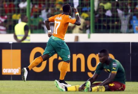 Serge Aurier of Ivory Coast celebrates after they won their 2015 African Cup of Nations Group D soccer match against Cameroon in Malabo