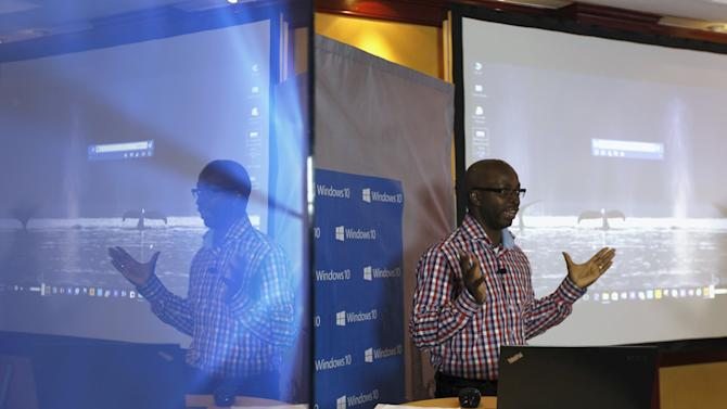 Olumide of Microsoft addresses delegates during the launch of the Windows 10 operating system in Kenya's capital Nairobi