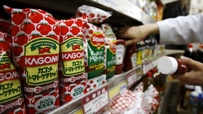 File photo of Kagome's tomato ketchup bottles displayed at Yoshiike supermarket in Tokyo