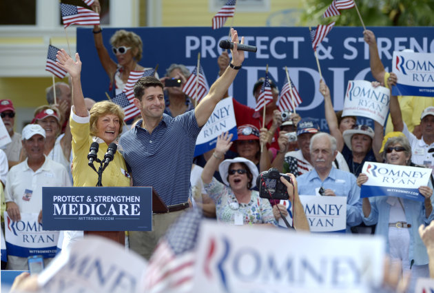 Republican vice-presidential candidate Rep. Paul Ryan, R-Wis., center left, and his mother Betty Ryan Douglas wave to supporters at a campaign rally in The Villages, Fla., Saturday, Aug. 18, 2012.(AP