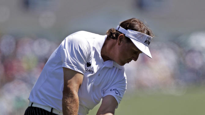 Phil Mickelson hits off the first fairway during the third round of the Masters golf tournament Saturday, April 7, 2012, in Augusta, Ga. (AP Photo/Chris O'Meara)
