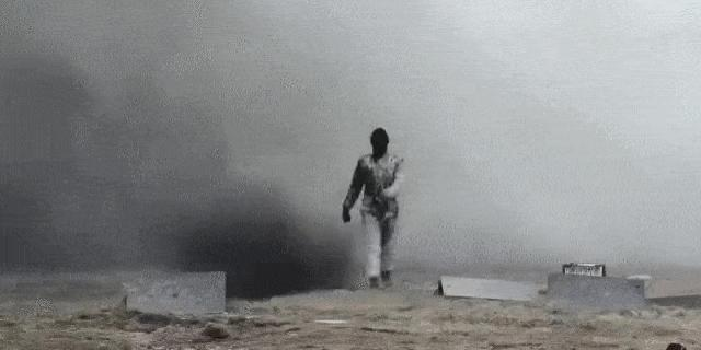 Russian Soldier Strolls Through a Gauntlet of Explosions Like It's Nothing