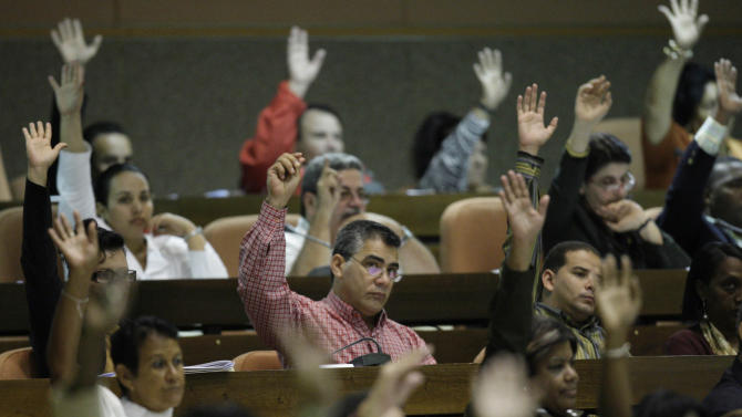 Members of the National Aassembly raise their hands to vote to send a message of solidarity to Venezuela's President Hugo Chavez during one of the assembly's twice-yearly gatherings in Havana, Cuba, Thursday, Dec. 13, 2012. Chavez underwent his fourth cancer-related operation in Havana. (AP Photo/Ismael Francisco, Cubadebate)