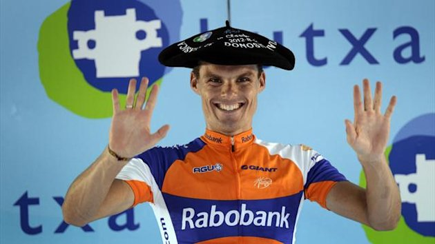 Rabobank rider Luis Leon Sanchez of Spain wears a traditional Basque beret as he celebrates his victory on the podium following the Clasica San Sebastian cycle race