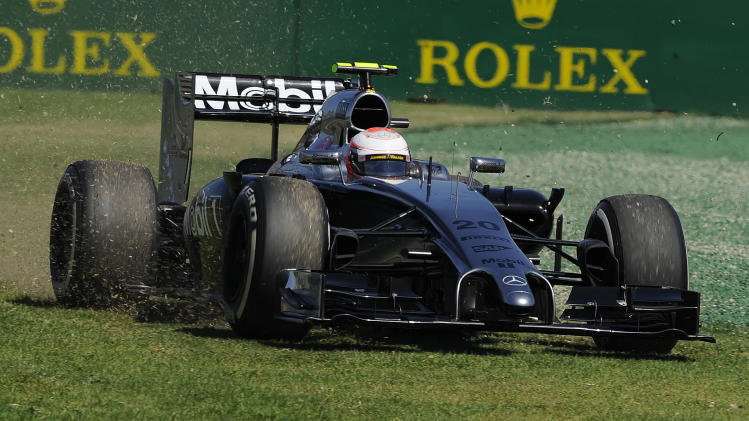 McLaren driver Kevin Magnussen of Denmark drives off the track on turn one during the first practice session for the Australian Formula One Grand Prix at Albert Park in Melbourne, Australia, Friday, March 14, 2014. (AP Photo/Andy Brownbill)