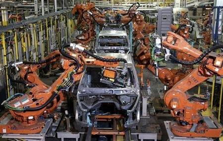 Auto assembly line robots weld on the frame of 2009 Dodge Ram pick-up trucks at the Warren Truck Assembly Plant in Warren, Michigan