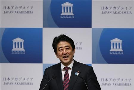 Japan's Prime Minister Abe smiles as he delivers a speech to business leaders and scholars during a meeting hosted by Japan Akademeia in Tokyo