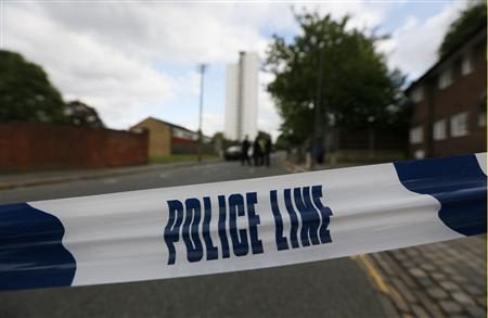 Police tape marks a cordon set up around a crime scene where one man was killed in Woolwich