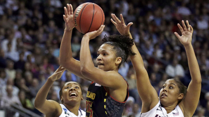 Maryland forward Alyssa Thomas, center, threads between Connecticut forward Morgan Tuck, left, and forward Kaleena Mosqueda-Lewis, right, during the first half of an NCAA women's college regional semifinal basketball game in Bridgeport, Conn., Saturday, March 30, 2013. (AP Photo/Charles Krupa)