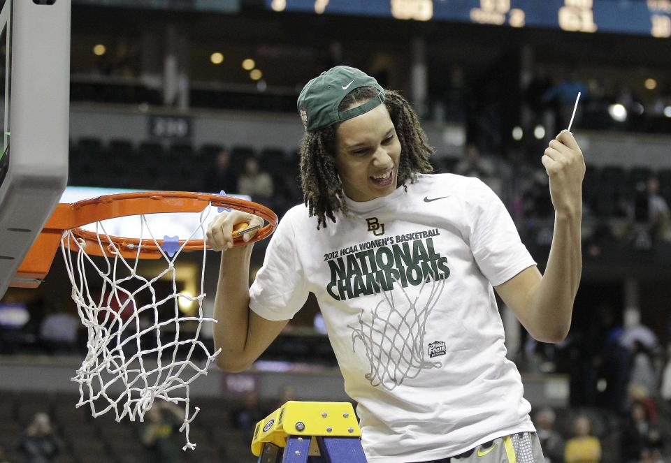 Baylor center Brittney Griner (42) cuts the net down during the second half in the NCAA Women's Final Four college basketball championship game against Notre Dame, in Denver, Tuesday, April 3, 2012.  Baylor won the championship 80-61. (AP Photo/Eric Gay)
