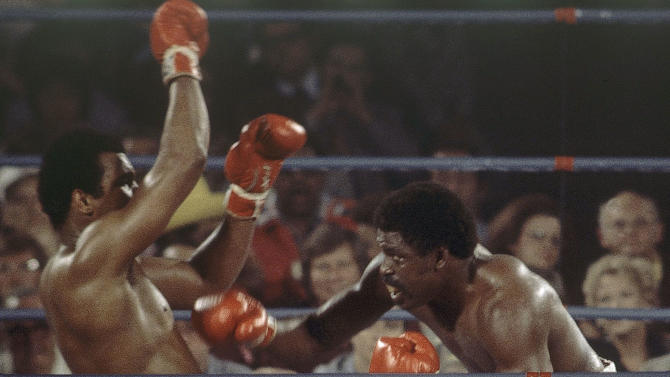 FILE - In this May 16, 1975, file photo, Muhammad Ali, left, battles Ron Lyle, during the 11th round of a heavyweight title bout in Las Vegas. Lyle, who fought Muhammad Ali for the title in 1975 and later battled George Foreman, died Saturday, Nov. 26, 2011, in Denver, a Salvation Army official said. He was 70.  (AP Photo/File)