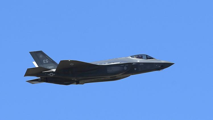 A U.S. Air Force F-35A Lightning II makes a flyby after an unveiling celebration takes place at Luke Air Force Base for the delivery of the first F-35A fighter jet, Friday, March 14, 2014, in Glendale, Ariz. It is the first delivery of an anticipated total of 144 F-35A planes destined for Luke AFB. (AP Photo/Ross D. Franklin)