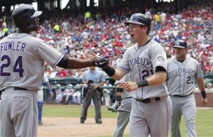 Rockies hold on for 11-7 victory against Rangers