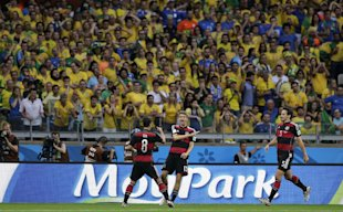 Germany's Thomas Mueller (C) celebrates after scoring the opening goal of the game. (AP)