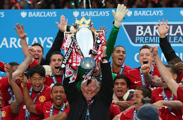 MANCHESTER, ENGLAND - MAY 12:  Manchester United Manager Sir Alex Ferguson lifts the Premier League trophy following the Barclays Premier League match between Manchester United and Swansea City at Old