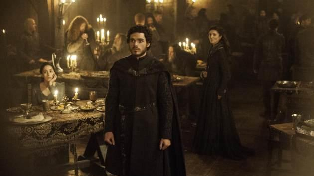 Talisa (Oona Chaplin), King in the North Robb Stark (Richard Madden) and Catelyn Stark (Michelle Fairley) at Lord Edmure Tully's wedding to Roslin Frey, aka The Red Wedding -- Helen Sloan/HBO