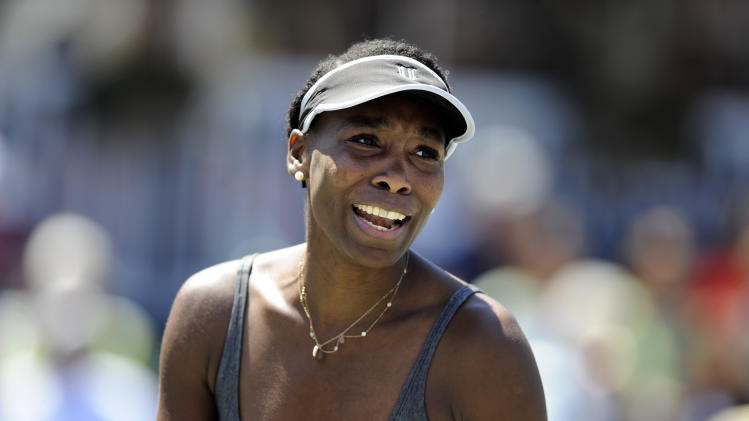Venus Williams reacts to a call during a semifinal match against her sister Serena Williams at the Family Circle Cup tennis tournament in Charleston, S.C., Saturday, April 6, 2013. Serena won 6-1, 6-2. (AP Photo/Stephen Morton)