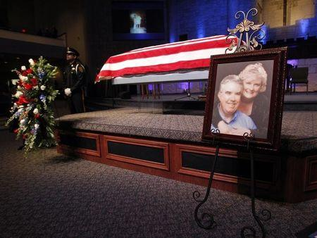 A photograph is displayed at a memorial service for Kaufman County district attorney Mike McLelland and his wife Cynthia in Sunnyvale