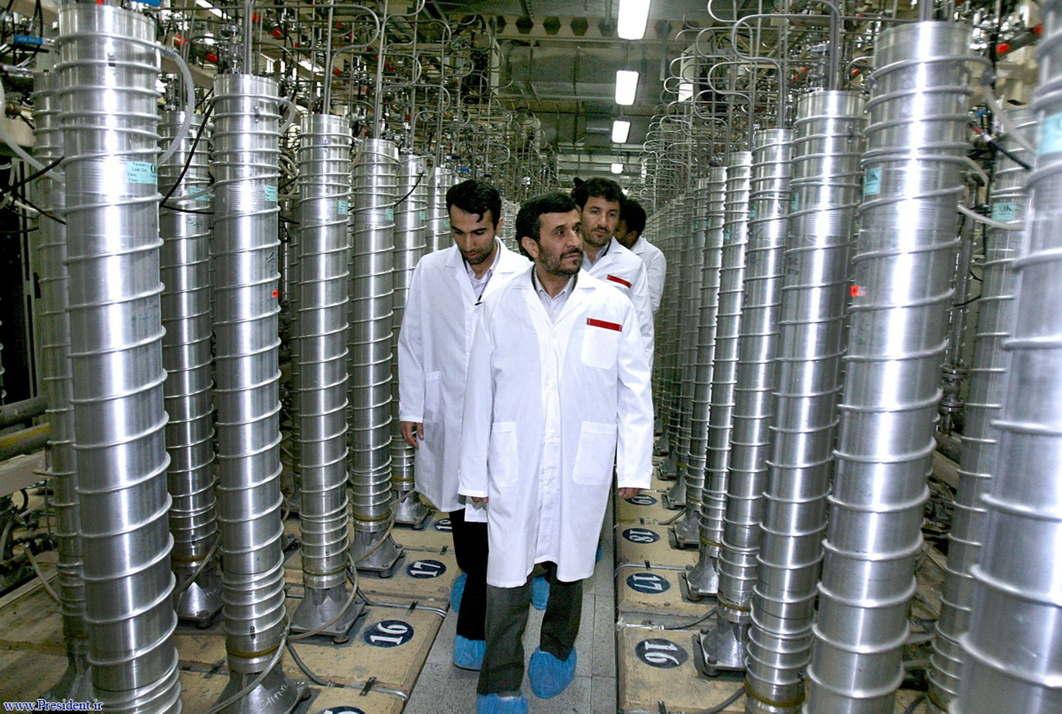 FILE - In this Tuesday, April 8, 2008 file photo released by the Iranian President's Office, Iranian President Mahmoud Ahmadinejad, center, visits the Natanz Uranium Enrichment Facility some 200 miles (322 kilometers) south of the capital Tehran, Iran, which is under International Atomic Energy Agency, IAEA, monitoring. The U.N. nuclear agency is investigating fears from its experts that their cell phones and lap tops have been hacked into by Iranian officials looking for confidential information. Diplomats told The Associated press Wednesday May 18, 2011 that the hardware apparently was tampered with while left unattended during inspection tours in the Islamic Republic.