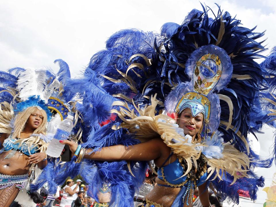 Miami-Dade carnival dancers perform at the annual Martin Luther King Day parade in Miami, Monday, Jan. 21,  2013, as the nation honors civil rights leader Martin Luther King Jr. (AP Photo/Alan Diaz)