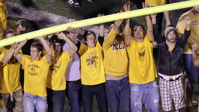 Missouri fans celebrate by tearing down a goal post following the Tigers' 36-27 victory over Oklahoma in an NCAA college football game Saturday, Oct. 23, 2010, in Columbia, Mo. (AP Photo/Jeff Roberson)