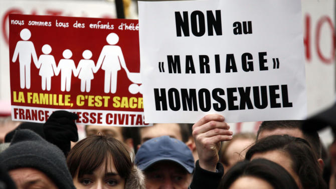 """Members of the fundamentalist Catholic group Civitas demonstrate with a poster reading """"No to Gay marraige"""" in Paris, Sunday, Jan. 13, 2013. Many thousands of protesters are mobilizing against the French president's plan to legalize gay marriage, streaming into Paris by bus, car and specially reserved high-speed train. Police are expecting about 300,000 people to march toward the Eiffel Tower from three different points in the city, tying up traffic and closing subway stations for hours in what could be the largest demonstration in a decade. (AP Photo/Michel Spingler)"""