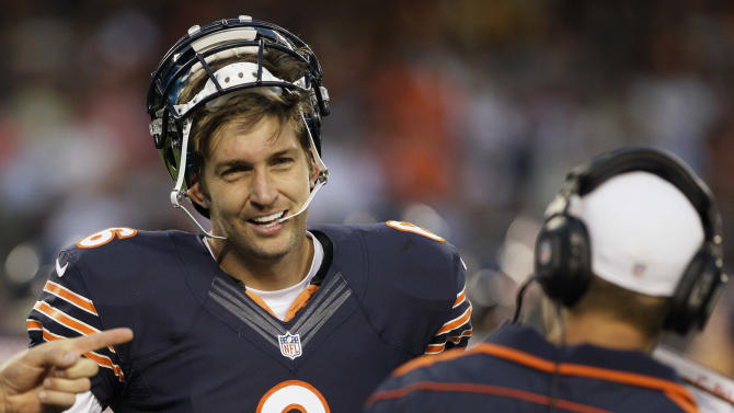 Chicago Bears quarterback Jay Cutler smiles as he talks with quarterbacks coach Jeremy Bates during the first half of an NFL preseason football game against the Washington Redskins in Chicago, Saturday, Aug. 18, 2012. (AP Photo/Nam Y. Huh)