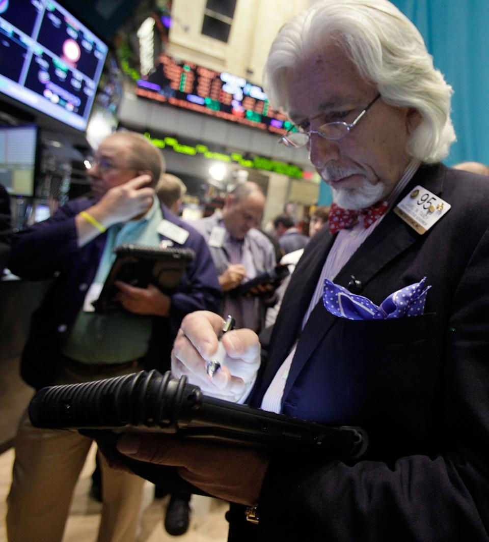 FILE -- In an Aug. 3, 2012 file photo trader Dan Tandy, right, works on the floor of the New York Stock Exchange.   U.S. stocks closed mixed Monday Aug. 27, 2012, on one of the quietest trading days of the year.   (AP Photo/Richard Drew)
