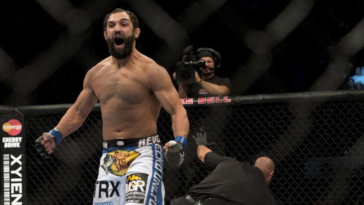 Johny Hendricks, from Dallas, reacts after knocking out Martin Kampmann, from Las Vegas, during the first round of their UFC Welterweight fight Sunday, Nov. 18, 2012 in Montreal. (AP Photo/The Canadian Press, Ryan Remiorz)