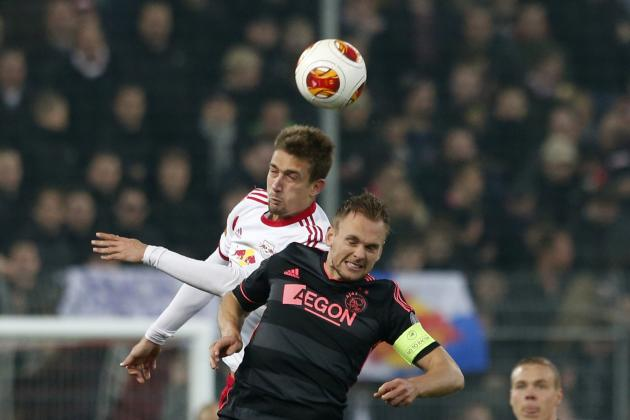 Salzburg's Ilsanker heads ball with Ajax Amsterdam's Jong during Europa League soccer match in Salzburg