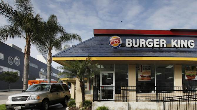 In this Thursday, April 25, 2013, photo, a car stops at the drive-thru at a Burger King restaurant near downtown Los Angeles. Burger King reports their quarterly earnings on Friday, April 26, 2013. (AP Photo/Nick Ut)