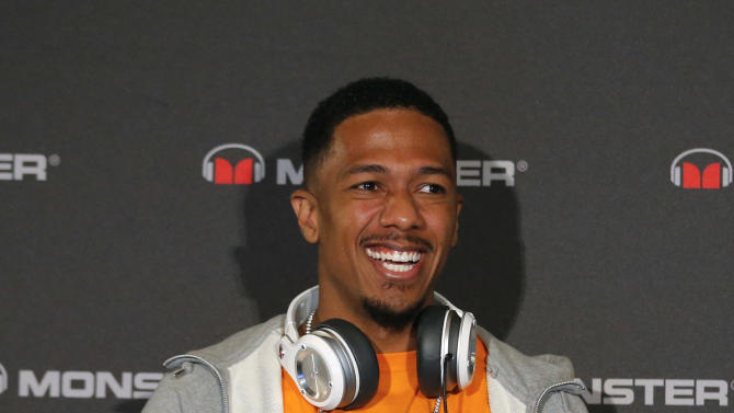 Recording artist Nick Cannon speaks during a new conference by Monster at the International Consumer Electronics Show in Las Vegas, Monday, Jan. 7, 2013. The 2013 International CES gadget show, the biggest trade show in the Americas, is taking place in Las Vegas this week. It's a place for technology companies to showcase the television sets, computers and other gadgets they plan. (AP Photo/Jae C. Hong)