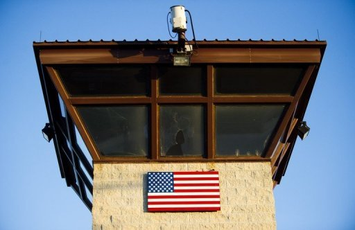 "The guard tower at the front gate of ""Camp Five"" and ""Camp Six"" detention facility at the US Naval Station in Guantanamo Bay is pictured. Lawyers for the alleged Al-Qaeda mastermind of the deadly 2000 attack on the USS Cole demanded Thursday that his Guantanamo military tribunal be televised"