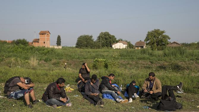 Syrian migrants take a rest in the village of Horgos near the Serbian border with Hungary