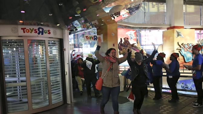 "Some of the first customers enter Toys ""R"" Us Times Square store during the early opening of the Black Friday sales in the Manhattan borough of New York"