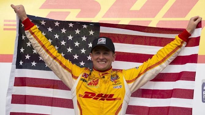 Ryan Hunter-Reay celebrates in victory circle after an IndyCar Series auto race at the Milwaukee Mile in West Allis, Wis., Saturday, June 15, 2013. (AP Photo/Jeffrey Phelps)
