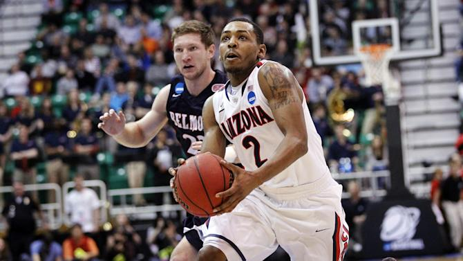 Arizona's Mark Lyons (2) drives to the basket past Belmont's Reece Chamberlain (22) in the second half during a second-round game in the NCAA college basketball tournament in Salt Lake City, Thursday, March 21, 2013. Arizona won 81-64. (AP Photo/Rick Bowmer)