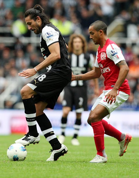 Newcastle United's Jonas Gutierrez, left, vies for the ball with Arsenal's Theo Walcott, right, during their English Premier League soccer match at St James' Park, Newcastle, England, Saturday, Aug. 13, 2011. (AP Photo/Scott Heppell) NO INTERNET/MOBILE USAGE WITHOUT FOOTBALL ASSOCIATION PREMIER LEAGUE(FAPL)LICENCE. CALL +44 (0) 20 7864 9121 or EMAIL info@football-dataco.com FOR DETAILS
