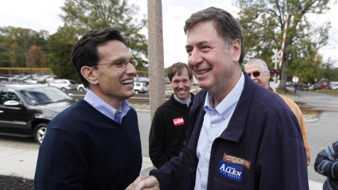U.S. Senate candidate former Sen. George Allen, right, greets U.S. Congressman Eric Cantor R-Va., as they campaign at Randolph-Macon college in Ashland, Va., Saturday, Nov. 3, 2012.  (AP Photo/Steve Helber)